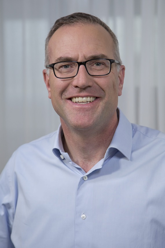 A photograph of Alexander Hardy, Chief Executive Officer of Genentech