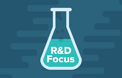 "An illustration of a flask containing a colored liquid, with the words ""R and D focus"" appearing over the liquid"